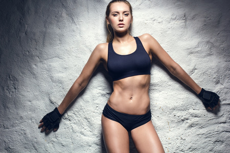 trained: attractive fitness woman, trained female body, lifestyle portrait, caucasian model Stock Photo