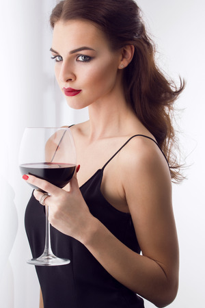 young gorgeous brunette with glass of red wine 스톡 콘텐츠