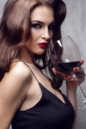 vip beautiful: young gorgeous brunette with glass of red wine Stock Photo