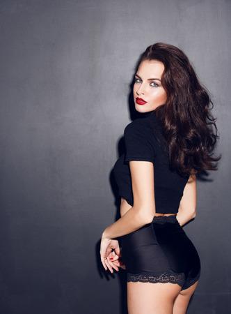 woman panties: young caucasian woman posing in studio Stock Photo