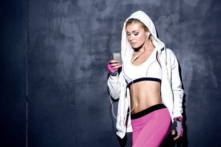 attractive fitness woman with mp3 player, caucasian model photo