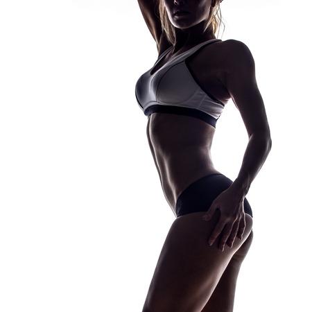 매력적인 피트 니스 여자, 훈련 된 여성의 몸, 라이프 스타일 초상화, 백인 모델의 실루엣 스톡 콘텐츠
