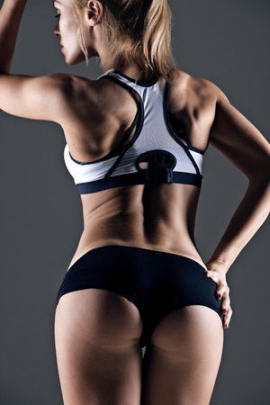 young female athlete back, trained buttocks, fit shape photo