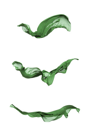 fabric design: abstract pieces of green fabric flying, high-speed studio shot