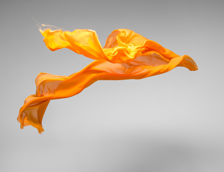 orange color: flying fabric - high speed studio shot, art object, design element
