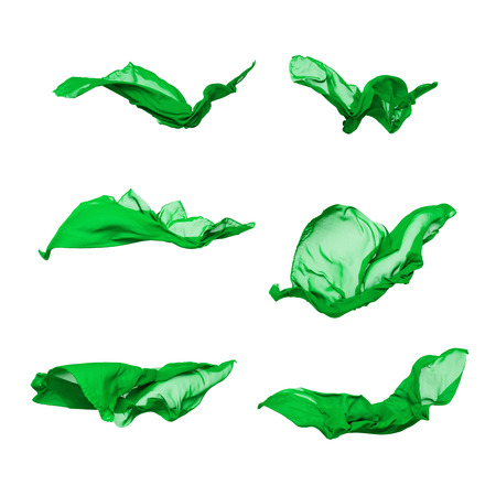 signe de la main: abstract pieces of fabric flying, isolated on white, design element Banque d'images