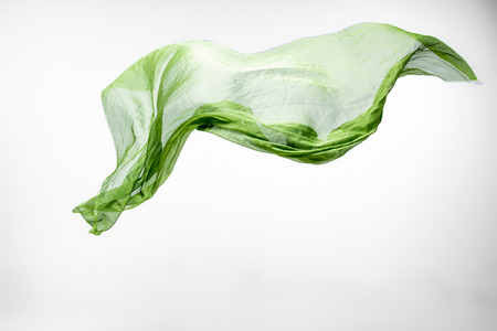 piece of green fabric flying, high speed studio shot, design element Stock Photo