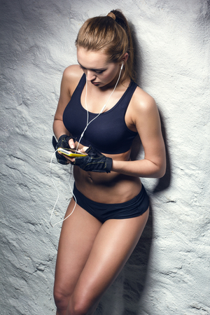 attractive fitness woman with mp3 player, caucasian brunette model photo