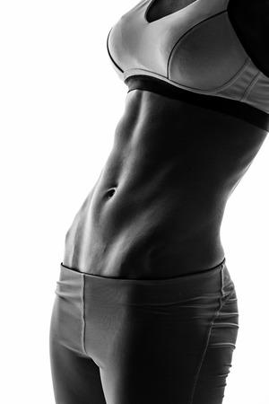 silueta humana: silueta de mujer atractiva de la aptitud, cuerpo femenino entrenado, retrato estilo de vida, cauc�sico modelo Foto de archivo