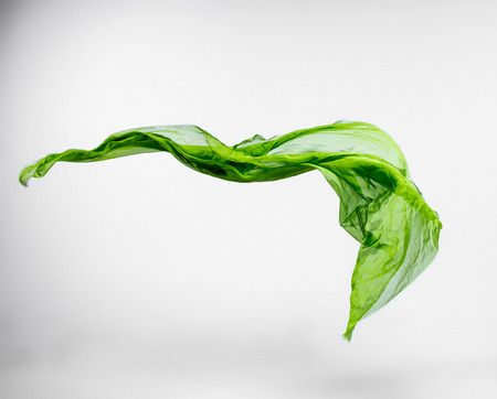 silk fabric: piece of green fabric flying, high speed studio shot, design element Stock Photo