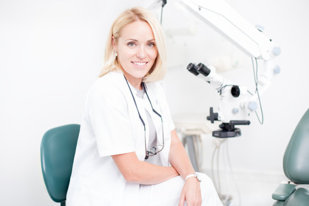 health professional: young professional female dentist in dental clinic Stock Photo