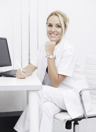 stomatologist: young professional female doctor in clinic Stock Photo