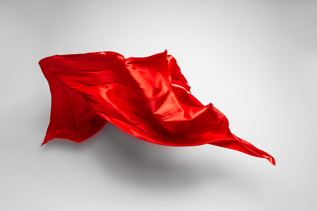 red cloth: piece of red fabric soaring, art object, design element Stock Photo