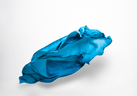 dynamic movement: abstract pieces of fabric flying, high-speed studio shot