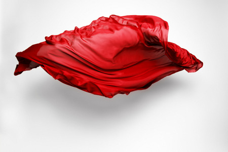 piece of red fabric soaring, art object, design element Stock Photo
