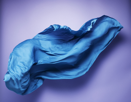 dynamic movement: abstract piece of blue fabric flying, art object, design element