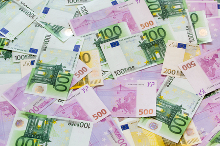 assorted euro banknotes arranged into background