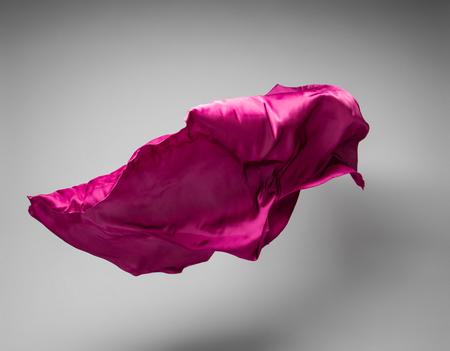 abstract piece of purple fabric flying, art object, design element Foto de archivo