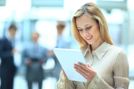 group business: Handsome businesswoman using his digital tablet