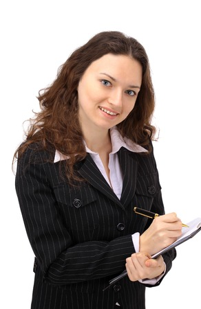 Glowing young businesswoman taking notes on her clipboard against a white  photo