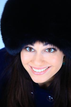 beautiful girl in a fur hat photo