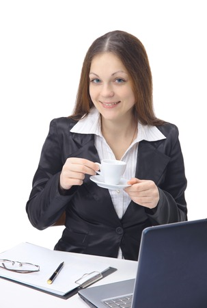 Happy young woman filling a business form while on her desk at work  photo