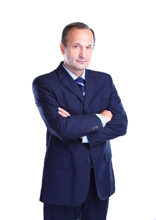 Portrait of an old businessman in suit with crossed arms isolated in a white background