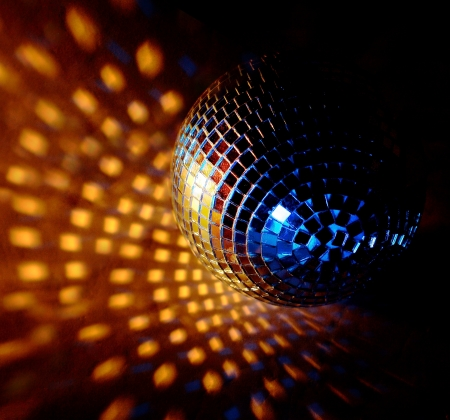 closeup of a mirrorball on a white background  Standard-Bild