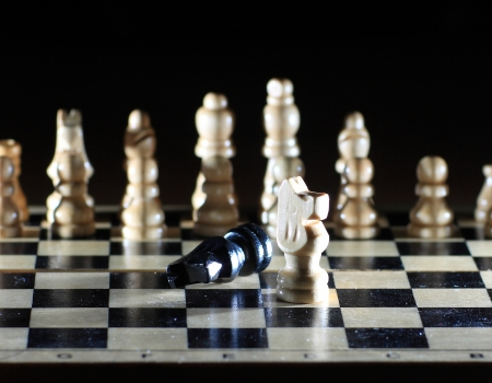 chessmen: Composition with chessmen on glossy chessboard  Stock Photo