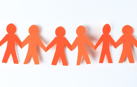 hand holding paper: teamwork, paper people over white background
