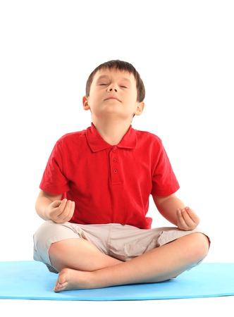 Childrens yoga. The little boy does exercise. photo