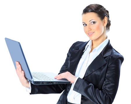 Beautiful businesswoman keeps the laptop. photo