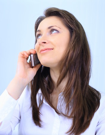 Young business woman holding the phone photo