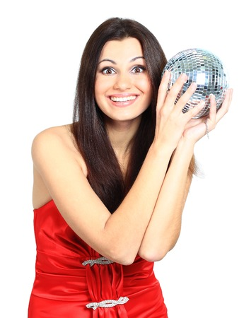 Attractive young beautiful woman with disco ball photo