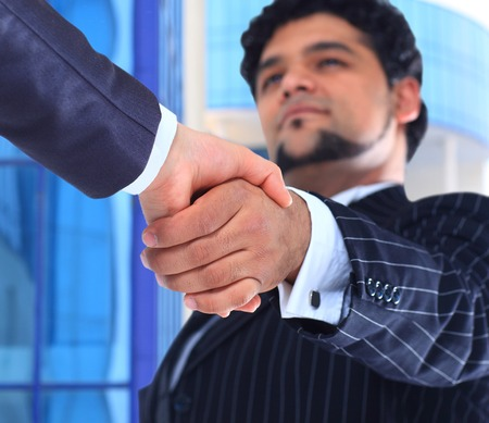 The conclusion of the transaction. Handshake. photo