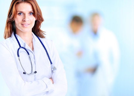 female doctor: Smiling medical woman doctor at Hospital Stock Photo