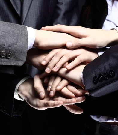 partnership power: Team work concept. Business people joining hands Stock Photo