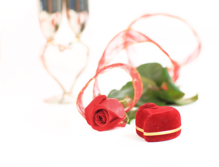 a rose and a box with rings photo