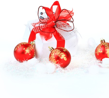 christmas gift with red balls bow photo