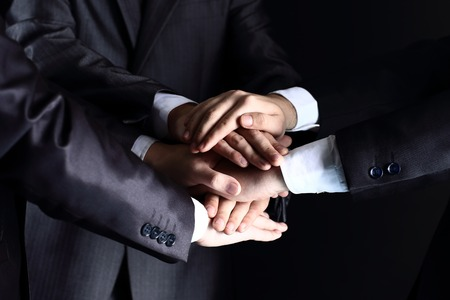 Team work concept. Business people joining hands Standard-Bild