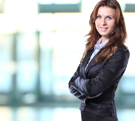 female boss: Successful business woman looking confident and smiling