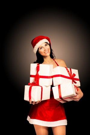 Santa hat Christmas woman holding christmas gifts smiling happy and excited. photo