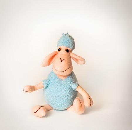 soporific: soft toy lamb on a white background