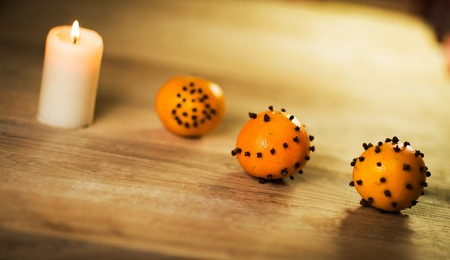 New year decoration tangerines on wooden table photo