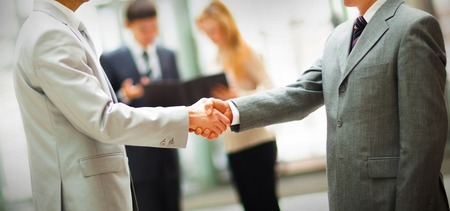 Business people shaking hands, finishing up a meeting 版權商用圖片