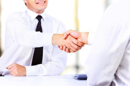 partnership power: Close up image of business handshake at meeting. Partnership concept