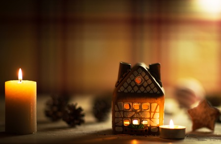 fairy Christmas house cake with candle light inside and nice background lights photo