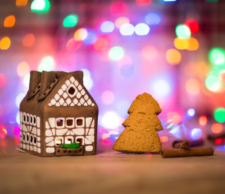 fairy Christmas house cake with candle light inside, narrow depth of field and background lights photo