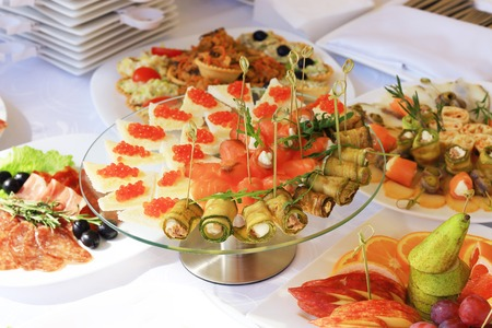 holiday catering: catering table set service with silverware and glass stemware at restaurant before party Stock Photo
