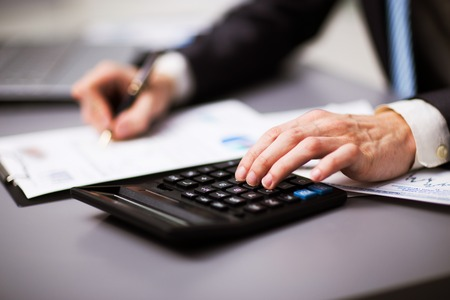 Man doing his accounting, financial adviser working Archivio Fotografico